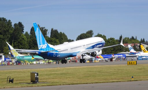 The final version of the 737 MAX, the MAX 10, passes other 737 MAX planes as it takes off from Renton Airport in Renton, Wash., on its first flight Friday, June 18, 2021. The plane will fly over Eastern Washington and then land at Boeing Field.  (Ellen M. Banner/The Seattle Times via AP, Pool)