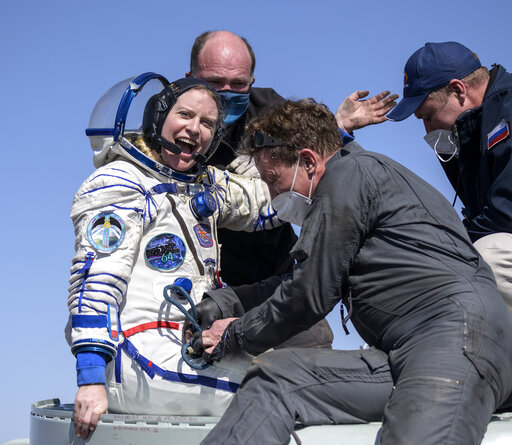 Expedition 64 NASA astronaut Kate Rubins is helped out of the Soyuz MS-17 spacecraft just minutes after she, and Roscosmos cosmonauts Sergey Kud-Sverchkov and Sergey Ryzhikov landed in a remote area near the town of Zhezkazgan, Kazakhstan on Saturday, April 17, 2021. Rubins, Ryzhikov and Kud-Sverchkov returned after 185 days in space having served as Expedition 63-64 crew members onboard the International Space Station. (Bill Ingalls/NASA via AP)