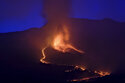 Lava flows from a volcano on the Canary island of La Palma, Spain in the early hours of Sunday Sept. 26, 2021. A volcano in Spain's Canary Islands is keeping nerves on edge several days since it erupted, producing loud explosions, a huge ash cloud and cracking open a new fissure that spewed out more fiery molten rock. (AP Photo/Daniel Roca)