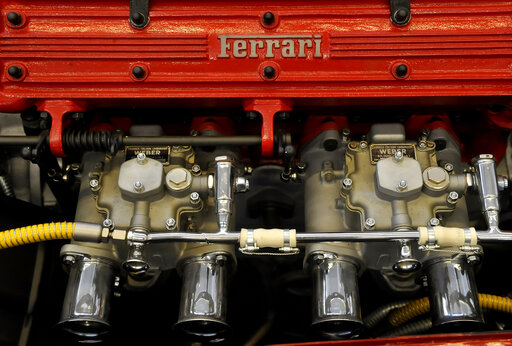 FILE - In this May 8, 2013 file photo a Ferrari logo is displayed on a engine in the department Ferrari factory in Maranello in Maranello, Italy. Luxury sports-car maker Ferrari has surged back to second-quarter growth, posting a 206-million-euro ($245 million) profit on Monday, Aug. 2, 2021, after seeing its earnings drop precipitously in the same period a year ago due to the pandemic shutdown. (AP Photo/Marco Vasini, File)