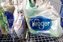 FILE - In this June 15, 2017, file photo, bagged purchases from the Kroger grocery store in Flowood, Miss., sit inside this shopping cart. Kroger is teaming up with Instacart on a new delivery service that can get grocery items to customers in as few as 30 minutes. The announcement comes at a time when many people are having groceries delivered for convenience and want their items to arrive quickly. Kroger Co. said Tuesday, Sept. 14, 2021 that the service, called Kroger Delivery Now, will offer 25,000 items and reach up to 50 million homes. (AP Photo/Rogelio V. Solis, File)