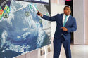 Co-anchor and meteorologist Jason Frazer rehearses on the Fox Weather set at News Corporation headquarters in New York, Wednesday, Oct. 20, 2021. Fox Weather, a free streaming service and app, will launch on Monday. (AP Photo/Richard Drew)