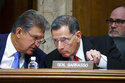 FILE - In this June 23, 2021, file photo, Sen. Joe Manchin, D-W.Va., chair of the Senate Energy and Natural Resources Committee holds a hearing with Ranking Member Sen. John Barrasso, R-Wyo., right, at the Capitol in Washington. A former federal law enforcement officer is alleging that President Joe Biden's pick to oversee federal lands in western states stonewalled a 1989 investigation into the sabotage of an Idaho timber sale. The allegation against U.S. Bureau of Land Management nominee Tracy Stone-Manning was made in a letter from a retired investigator released Thursday, July 15, 2021, by Sen. Barrasso. (AP Photo/J. Scott Applewhite, File)