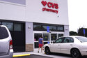 A customer walks into a CVS Pharmacy store, Tuesday, Aug. 3, 2021, in Woburn, Mass.  Customers returned to CVS Health stores to fill prescriptions and get COVID-19 tests and vaccines, helping to push the health care giant past Wall Street's second-quarter expectations.  (AP Photo/Charles Krupa)