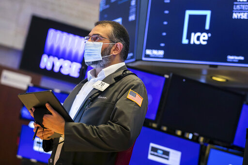 In this photo provided by the New York Stock Exchange, trader Aman Patel works on the floor of the NYSE, Monday, June 14, 2021. Stocks fell on Wall Street Monday in a sluggish start to the week as investors await the latest take from the Federal Reserve on inflation. (Courtney Crow/New York Stock Exchange via AP)