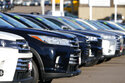 This Nov. 15, 2020 photo shows a long row of unsold used Highlander sports-utility vehicles sits at a Toyota dealership in Englewood, Colo.  In 2021,  high demand and low supply have driven up used vehicle prices so much that many are now selling for more than their original sticker price when they were new. (AP Photo/David Zalubowski)