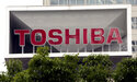 """FILE - This May 26, 2017 file photo shows the company logo of Toshiba Corp. displayed in front of its headquarters in Tokyo.Trading in Toshiba stock was halted Wednesday, April 7, 2021 after the Tokyo-based technology conglomerate confirmed it had received a preliminary acquisition proposal. Toshiba Corp. said Tuesday, April 6 it had asked for more details on the proposal, was giving it """"careful consideration"""" and would make an announcement """"in due course."""" (AP Photo/Koji Sasahara, File)"""