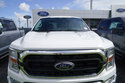 A Ford F150 XL truck is displayed, Monday, July 26, 2021, at a dealership in Hialeah, Fla. Sky-high sales prices for its pickup trucks and SUVs helped Ford Motor Co. turn a surprise second-quarter profit despite a global shortage of computer chips that cut production. (AP Photo/Marta Lavandier)