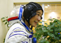 Space flight participant Yusaku Maezawa attends a training session ahead of the expedition to the International Space Station at the Gagarin Cosmonauts' Training Center in Star City outside Moscow, Russia, Thursday, Oct. 14, 2021. A Japanese fashion tycoon who's booked a SpaceX ride to the moon is going to try out the International Space Station first. Yusaku Maezawa announced that he's bought two seats on a Russian Soyuz capsule. He'll blast off in December on the 12-day mission with his production assistant and a professional cosmonaut. (Shamil Zhumatov/Pool Photo via AP)