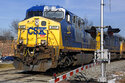 FILE - In this Feb. 12, 2018, file photo a CSX freight train passes through Homestead, Pa. CSX delivered a 32% jump in third-quarter profit as the volume of goods it hauled increased even beyond last fall's strong level. The Jacksonville, Florida-based railroad said Wednesday, Oct. 20, 2021 that it made $968 million, or 43 cents per share, in the quarter. That's up from $736 million, or 32 cents per share, a year ago.(AP Photo/Gene J. Puskar, File)
