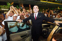FILE - In this May 27, 2003, file photo, employees surround Nissan CEO Carlos Ghosn as he stands in the door of a Quest minivan at the opening of the $1.4 billion plant in Canton, Miss. In an interview with The Associated Press, the embattled former chairman of the Renault-Nissan-Mitsubishi alliance dissected his legal troubles in Japan, France and the Netherlands, detailed how he plotted his brazen escape from Osaka, and reflected on his new reality in crisis-hit Lebanon, where he is stuck for the foreseeable future. (AP Photo/Rogelio V. Solis, File)