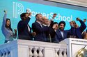 PowerSchool CEO Hardeep Gulati, second from right, rings the New York Stock Exchange opening bell, celebrating his company's IPO, Wednesday, July 28, 2021. Low interest rates and hefty returns have driven record demand for IPOs, but with valuations for newly public companies now at levels last seen during the dot-com bubble, some analysts are raising concerns that boom may be nearing an end. Last quarter was the U.S.'s biggest for initial public offerings in over two decades, with 115 companies raising proceeds of $40.7 billion, according to Renaissance Capital. This demand has driven valuations to levels not seen since since two decades ago. (AP Photo/Richard Drew, file)