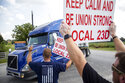 FILE - In this Sept. 13, 2021 file photo, members of Local 23D Union picket in front of Heaven Hill Distillery in Bardstown, Ky.   Heaven Hill, one of the world's largest bourbon producers, announced a tentative contract deal Friday, Oct. 22,  with striking union workers, just days after signaling it intended to start hiring permanent replacement employees for bottling and warehouse operations in Kentucky.(Silas Walker/Lexington Herald-Leader via AP, File)