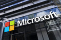 """This May 6, 2021 photo shows a sign for Microsoft offices in New York.  Microsoft has unveiled the next generation of its Windows software, called Windows 11, that has a new """"start menu"""" and other features. The newest version of Microsoft's flagship operating system announced Thursday, June 24,  will be a successor to today's Windows 10, which the company introduced in 2015.  (AP Photo/Mark Lennihan)"""