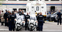 Tucson Police officers and other law enforcement officers stand at attention as the body of a Drug Enforcement Administration special agent is removed from an Amtrak train and loaded into a van from the Pima County Medical Examiner following a shooting Monday, Oct. 4, 2021, in Tucson, Ariz. (Rebecca Sasnett/Arizona Daily Star via AP)