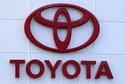 FILE - The Toyota logo is shown on a dealership in Manchester, N.H., in this Thursday, Aug. 15, 2019, file photo. Toyota plans to build a new $1.29 billion factory in the U.S. to manufacture batteries for gas-electric hybrid and fully electric vehicles. The plant location wasn't announced, but the company said it eventually will employ 1,750 people and start making batteries in 2025, gradually expanding through 2031. (AP Photo/Charles Krupa, File)
