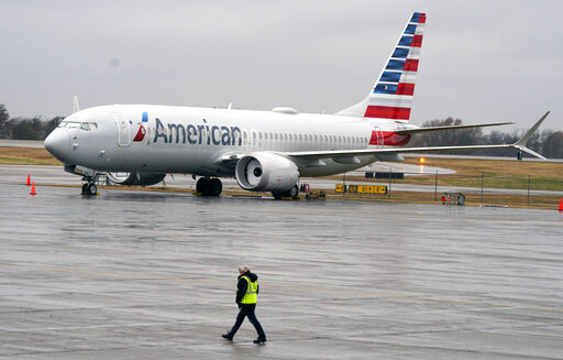 FILE - An American Airlines Boeing 737 Max jet plane is parked at a maintenance facility in Tulsa, Okla., Wednesday, Dec. 2, 2020. A former Boeing test pilot pleaded not guilty Friday, Oct. 15, 2021, to charges that he deceived regulators by withholding information about a key system that played a role in two deadly crashes involving Boeing 737 Max jets. (AP Photo/LM Otero, File)
